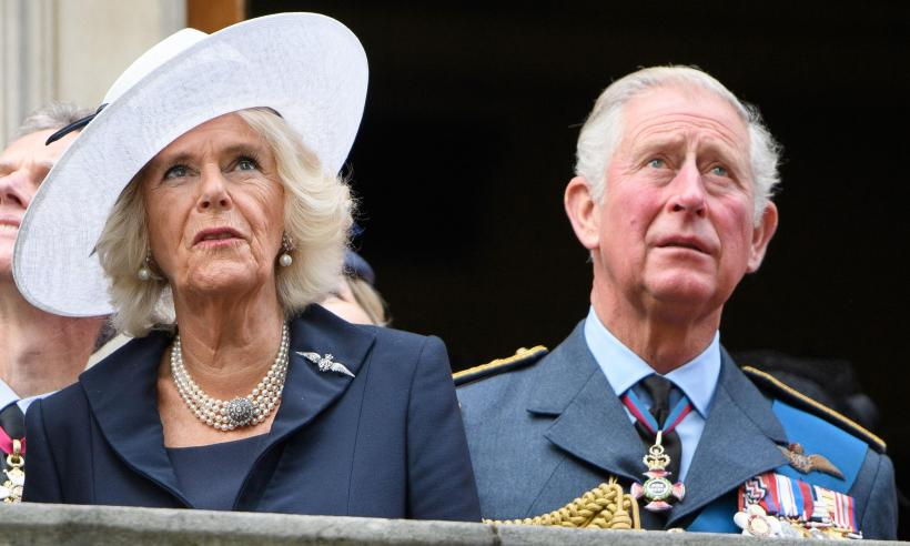 Prince Charles and Camilla chat to stallholders at Ely Markets